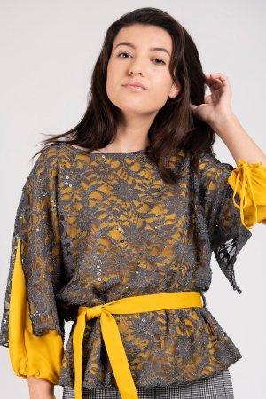 Model wearing double layered women's top with grey lace and yellow satin | Haruco-vert