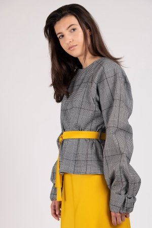 Model wearing black and white houndstooth women's top with oversized sleeves | Haruco-vert